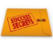 Success Secrets Winning Information Classified Envelope. A yellow envelope with a red stamp with the words Success Secrets full of  information on succeeding or Royalty Free Stock Image