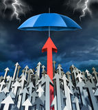 Success Security. And safe investment financial concept with a group of arrows going up and an individual successful red arrow being protected by an umbrella Royalty Free Stock Image