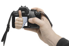 Success Shot. A hand appears out of the display of a digital camera Stock Photography