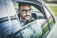 Success is sometimes not easy. Young smiling business sitting in car. Close up stock photos