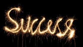 Success sparkler. Success word sparkler on dark Stock Photo