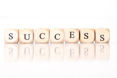 Success, spelled with dice letters Royalty Free Stock Image