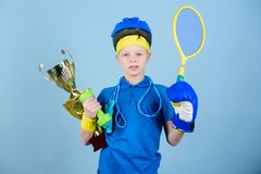 Success in sport. Proud of achieved success. Succeed in everything. Athlete successful boy sport equipment jump rope. Boxing glove tennis racket roller skate stock photo