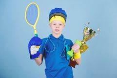Success in sport. Proud of achieved success. Succeed in everything. Athlete successful boy sport equipment jump rope. Boxing glove tennis racket roller skate royalty free stock photos