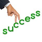 Success stair. Business hand as finger step on success word Royalty Free Stock Image