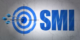 Stock market indexes concept: target and SMI on wall background. Success Stock market indexes concept: arrows hitting the center of target, Blue SMI on wall Stock Image