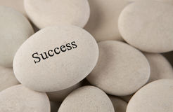 Success. Stone with engraved Success on rock background Royalty Free Stock Images
