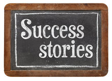 Success stories on blackboard Stock Image