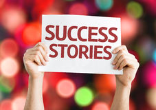 Success Stories card with colorful background with defocused lights stock photo