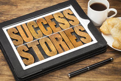 Success stories on digital tablet Royalty Free Stock Photos