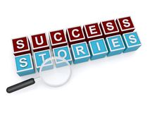 Success stories. Toy blocks spelling success stories in 3D graphics in red, blue and white text with magnifying glass Royalty Free Stock Image