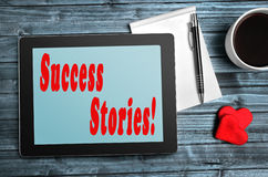 Success Stories words. On digital tablet Stock Images
