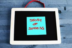 Success story concept written on blackboard Stock Photo