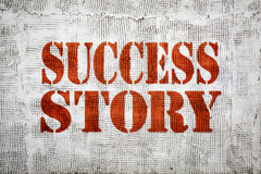 Success story sign painted on grunge stucco texture wall Royalty Free Stock Photos