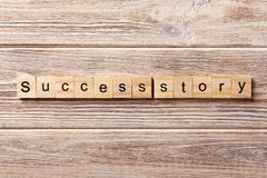 Success story word written on wood block. Success story text on table, concept.  Stock Photo