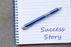 Success story write on notebook Stock Image