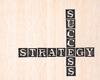 Success and strategy word stamped on wooden Stock Photos