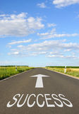 Success - Street with arrow and text. Blue sky in the background stock photo
