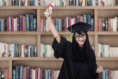 Success student in graduation gown Stock Image