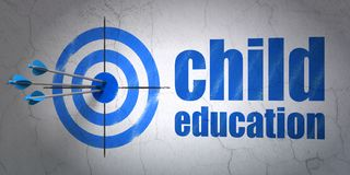 Studying concept: target and Child Education on wall background. Success Studying concept: arrows hitting the center of target, Blue Child Education on wall Royalty Free Stock Photos