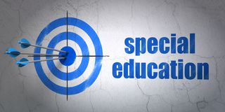 Studying concept: target and Special Education on wall background Royalty Free Stock Images