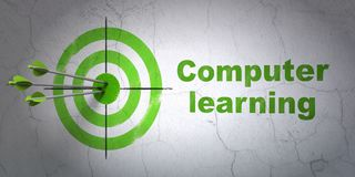Studying concept: target and Computer Learning on wall background Royalty Free Stock Image