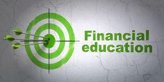 Studying concept: target and Financial Education on wall background. Success Studying concept: arrows hitting the center of target, Green Financial Education on Royalty Free Stock Images