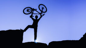 Success of the summit by mountain bike. Adventurer biker royalty free stock photos