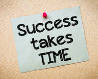 Success takes time. Message. Recycled paper note pinned on cork board. Concept Image Stock Images