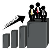 Success team. A group of businessmen working as a team reaching success Royalty Free Stock Photo