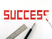 success, text design sketch and painting on white paper background Stock Image