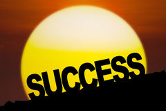 Success text on the hill at sunset Stock Images