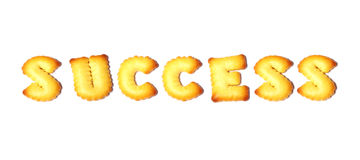 Success text made of cookies isolated on white background Stock Photo