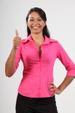 Success thumbs up from beautiful young woman Stock Photo