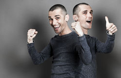 Success, thumbs up, ecstatic expressions with two-headed happy man Royalty Free Stock Image