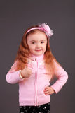 Success thumbs up sign. She has a big happy smile. Royalty Free Stock Image