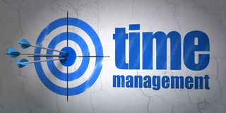 Time concept: target and Time Management on wall background. Success time concept: arrows hitting the center of target, Blue Time Management on wall background Stock Image
