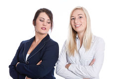 Success: two satisfied business women smiling in business outfit Royalty Free Stock Photos