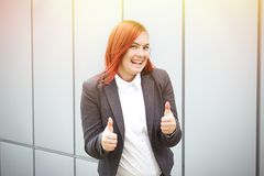 Success! Victory! Happy successful red-haired girl boss, busines Stock Image