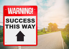 Success this way signage on road ahead. Stock Image