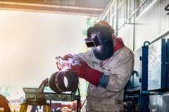 Welding steel construction. The success of welding craftsman worker arc welding at pipe shop in project site Royalty Free Stock Photos