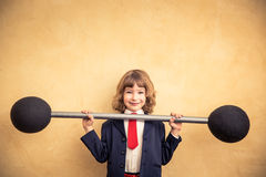 Success and winner business concept. Strong businessman child holding barbell. Success and winner business concept Royalty Free Stock Images