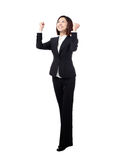 Success winner business woman in full length. Success / winner business woman isolated. Funny image of celebrating happy young businesswoman in full length with Royalty Free Stock Photos