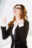 Success, winner businesswoman. With fists up Stock Image