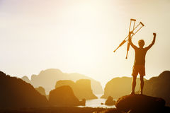 Success or winner concept with disabled man and crutches Royalty Free Stock Photography