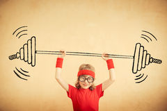 Success and winner concept. Funny nerd kid with drawn barbell. Success and winner concept Stock Photo