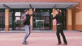 Success, winning, achievement, happiness of business people. man and woman having fun dancing and goofing around having. Two businessmen are having fun and stock video footage