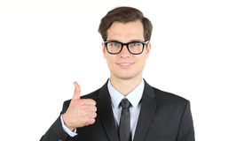success and winning concept - happy business man giving thumbs up royalty free stock images