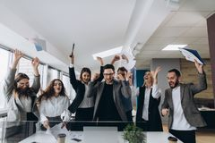 Success and winning concept happy business team celebrating victory in office. Success and winning concept - happy business team celebrating victory in office royalty free stock image
