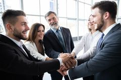 Success and winning concept - happy business team celebrating victory in office. Success and winning concept - happy business team celebrating victory in office royalty free stock image